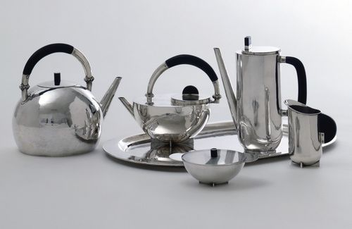 Marianne Brandt (German, 1893-1984). Coffee and Tea Set, 1924. Silver and ebony, lid of sugar bowl made of glass. Tray: 13 x 20 1/4 in. (33 x 51.5 cm). Purchased with funds from the Stiftung Deutsche Klassenlotterie Berlin. Photo: Fred Kraus.
