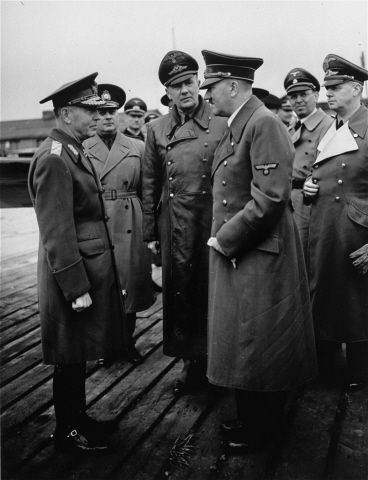 Romanian dictator, Marshal Ion Antonescu (left), converses with Adolf Hitler during an official visit to Germany, as Nazi officials look on.Pictured in the center is Hitler's interpreter, Paul Schmidt. Second from right is Julius Schaub, Hitler's senior SS adjutant, and at the far right, German foreign minister Joachim von Ribbentrop.