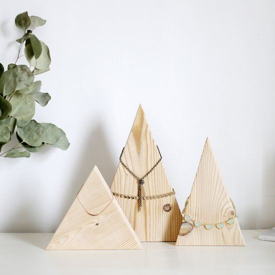 Organize your jewelry with this lovely wooden mountain necklace display.