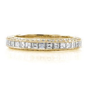 Passion Band - A sensational design made to match the Passion Engagement Ring. A mix of diamond shapes create a refined statement that stands out when worn on its own. The top of the band is channel set with carre cut stones with descending step-cut facets. The sides radiate with brilliance from the round cut diamonds.