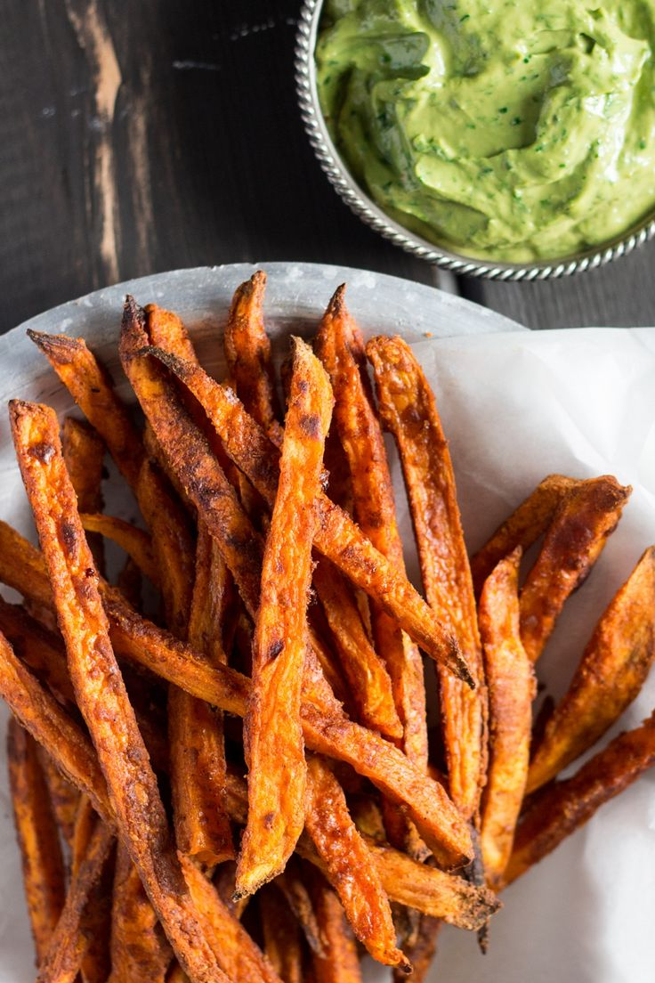 Crispy sweet potato fries with avocado-coriander dip make an irresistible vegan and gluten-free snack or a versatile sidedish.