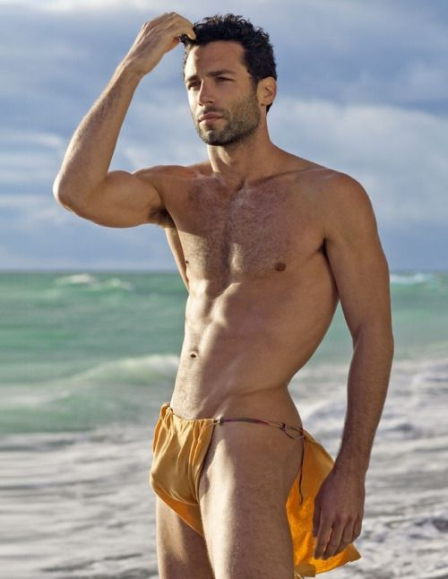 Pictures of muscular gay men wearing skimpy loincloths