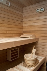 sauna- Timber Log Home in Spanish Mountains by Nordicasa Design & Construction