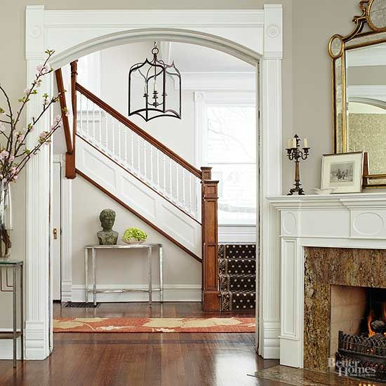 This entry staircase and railings stay in step with the home's Victorian origins.