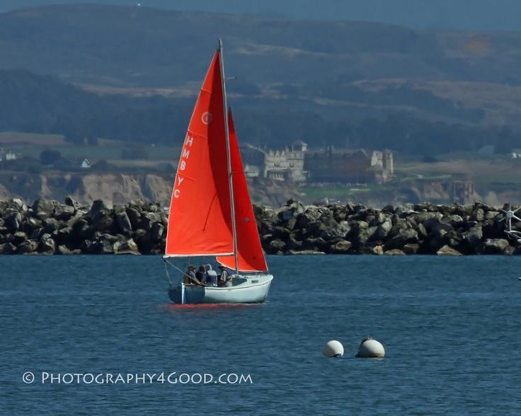 Half Moon Bay Yacht Club sailboat with Ritz Carlton in the distance (John Ediger - Photography4Good)