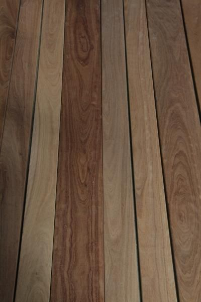 Ironbark - Grey and Red.  http://outlast.com.au/products/decking/ironbark-decking/