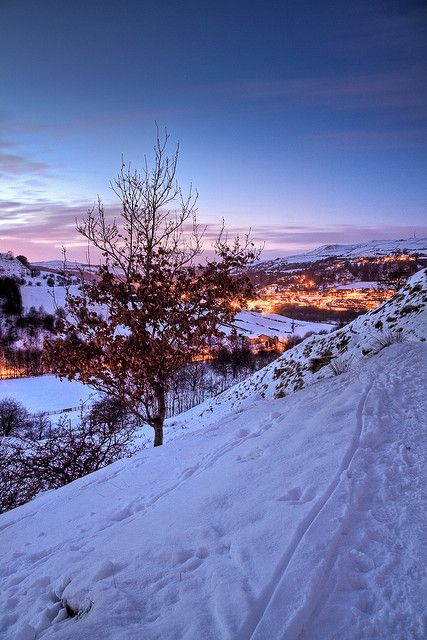 Dusk falls across a snowy Todmorden, West Yorkshire, England