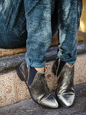 Centinela Ankle Boot | Metallic crackled leather pointy toe flat ankle boots. Elastic inserts at ankles.  *By Free People  *Please note, these boots run small. We recommend ordering up a half size.