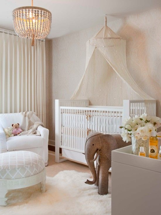 Flowers Baby Girl Bedroom Ideas : Exciting Transitional Baby Girl Nursery Ideas With Huge Elephant Doll Also White Modern Wooden Cradle And Elegant Padded Armchair With Round Footstool Also Pendant Lamp Also White Fur Rug Also White Flowers