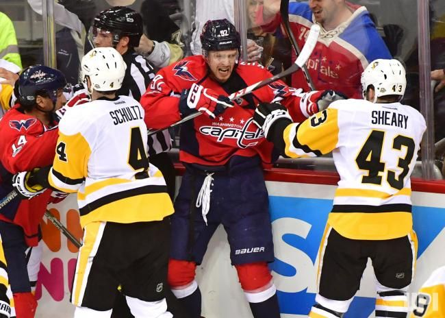 Member of Washington Capitals and Pittsburgh Penguins fight in the second period of the Eastern Conference Semifinals at the Verizon Center…