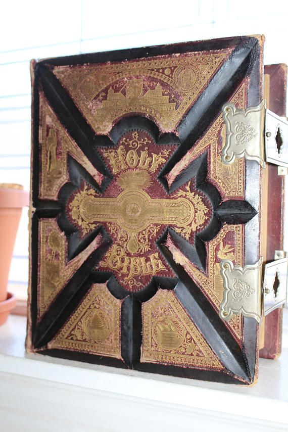 Large antique 1892 Holy Bible, a self pronouncing parallel bible with gorgeous gold highlighted leather cover, gold end pages, fully functional metal clasps and wonderfully illustrated. It weighs 15 lbs and measures 12 1/2 x 10 x 4 7/8 thick. Age appropriate wear, overall good