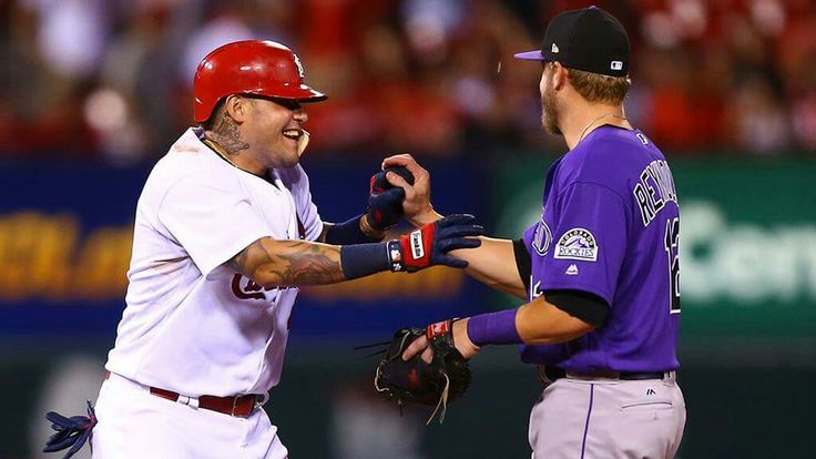 Yadi and the Rockies' Mark Reynolds, 7/24/17. Cards win.