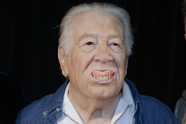 THEY'RE FAKE: Singer-songwriter Jack Clement popped his false teeth out as he joked with photographers Wednesday in Nashville, Tenn., after it was announced that he will be inducted into the Country Music Hall of Fame. (Mark Humphrey/Associated Press)