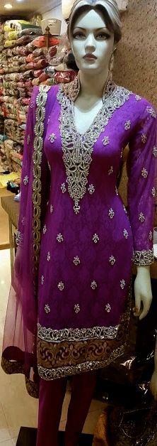 This Gorgeous Suit adds elegance and style to any wardrobe, Available in this Hot Pink and Burgundy .