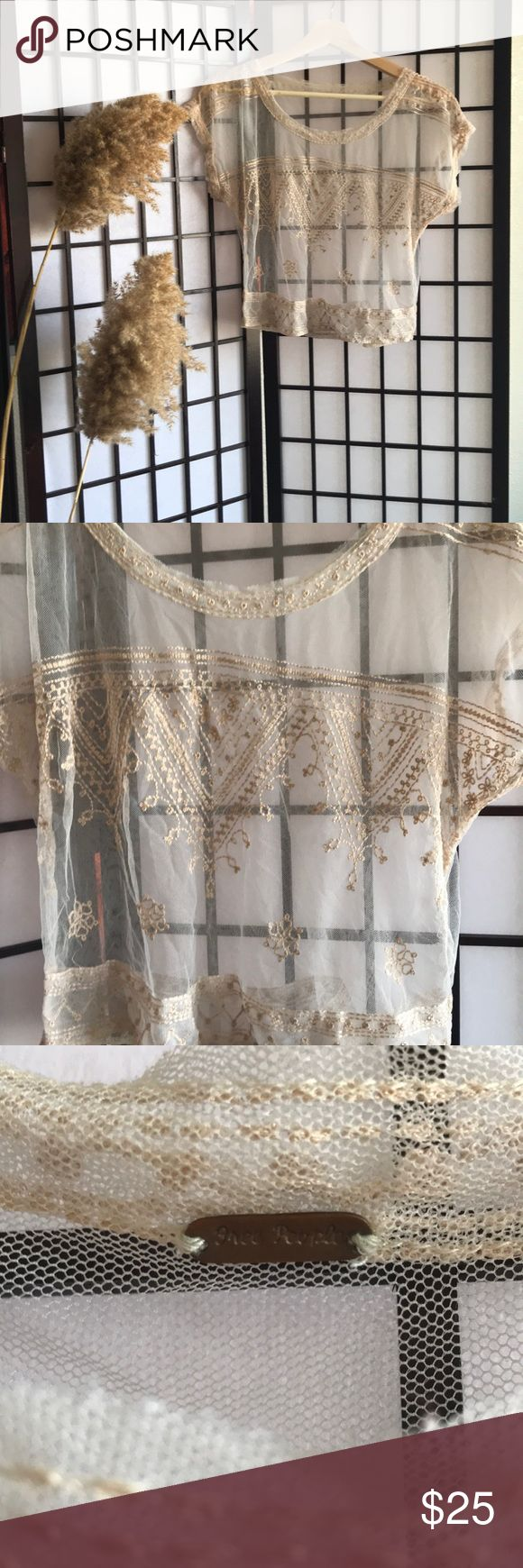 Free People Sheer Lace  Cream Crop Top Fun and flirty, perfect for showing of your favorite bralette.  Intricate and delicate lace and embroidery design throughout.   Sheer/ see thru material.  This cream lace crop top is missing its size tag, but fits like a medium. Free People Tops Crop Tops