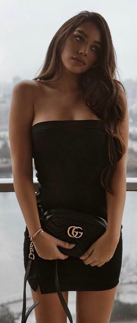 #winter #outfits  black strapless mini dress and black Gucci leather handbag. Pic by @lioness_official.