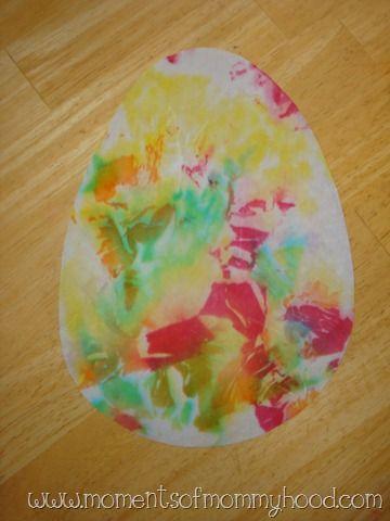 Tear tissue paper > Spray egg shaped construction paper > Put down tissue paper on wet egg > Spray again > Peel off tissue.