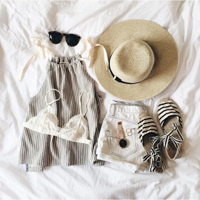 A linen halter top with a pair of light denim shorts, a straw hat, and espadrille sandals fit into your Summer picnic, pool party, or tropical travel plans.