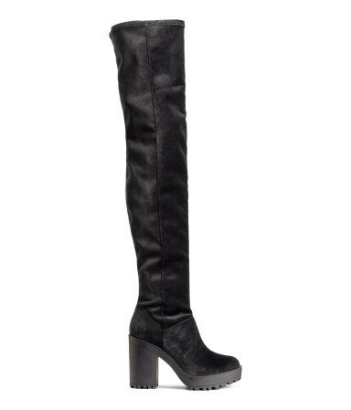 Thigh-high boots in soft velvet with chunky rubber soles. Front platform height 1 1/4 in., heel height 4 1/4 in.