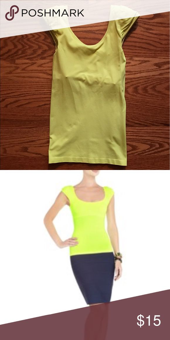 BCBG Maxazria Top Neon yellow top with padded shoulders. Built in bra. Form fitting. Add a pop to your outfit with this bright, fun top! BCBGMaxAzria Tops Tees - Short Sleeve