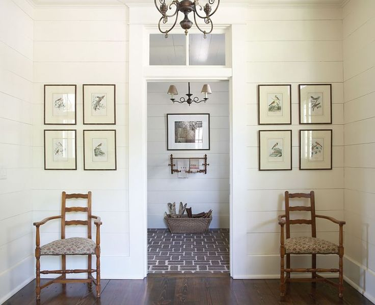 Beautiful Entry featuring shiplap walls and framed audubon prints.  | Design by Historical Concepts, photographed by Emily Followill