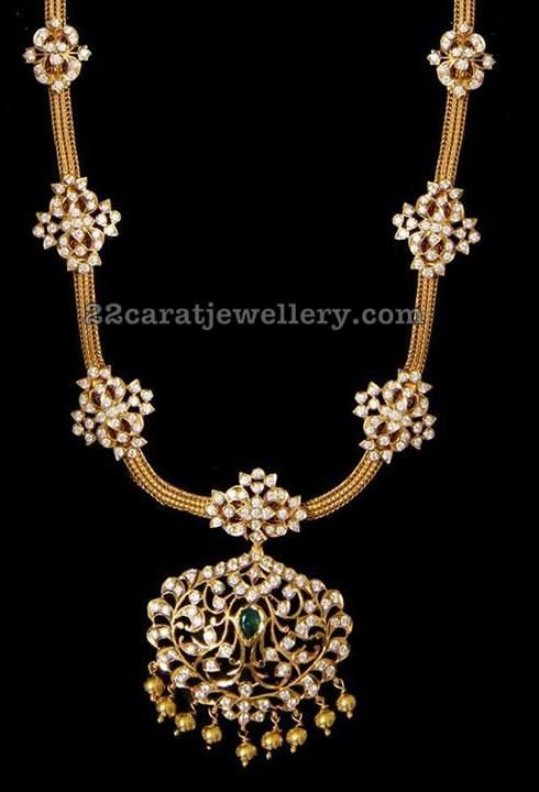 Pretty medium size diamond necklace , 22 carat gold antique finish simple mesh chain necklace, attached with diamonds studded flower motifs all over.