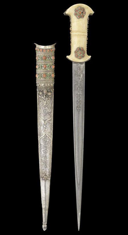 Ottoman dagger, 19th century, coral set walrus ivory hilt.