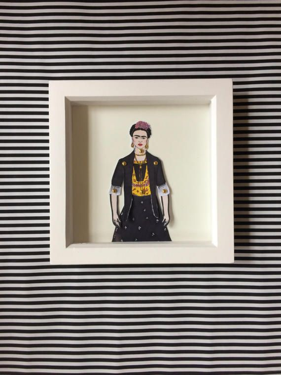 Frida Kahlo doll! These beautiful little dolls are hand illustrated by myself, hand cut and pinned using mini gold brad pins then framed.  The frames come in a lovely little package that can be personalized all you have to do is message me with who the gift is TO: and FROM: and I can pop that on ready for gifting.  All dolls are roughly 25cm tall and are professionally printed on sturdy 300gsm matt card before being hand cut and pinned. All framed doll sets come in a little dollylovesdallas…