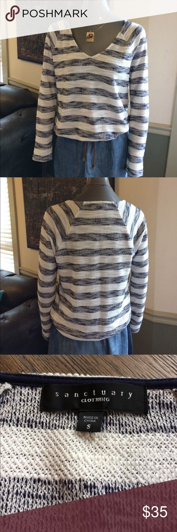 Sanctuary Anthropologie Striped Pullover Sweater EUC Sanctuary from Anthropologie striped pullover sweater. Navy & creamy white horizontal stripes. V-neck with thin elastic bottom. A very textured knit 83% Polyester / 17% Acrylic so it has a comfy stretch. Anthropologie Sweaters V-Necks