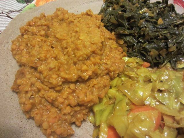 Gomen wat, atkilt wot, and lentils with red kulet. Ethopian food