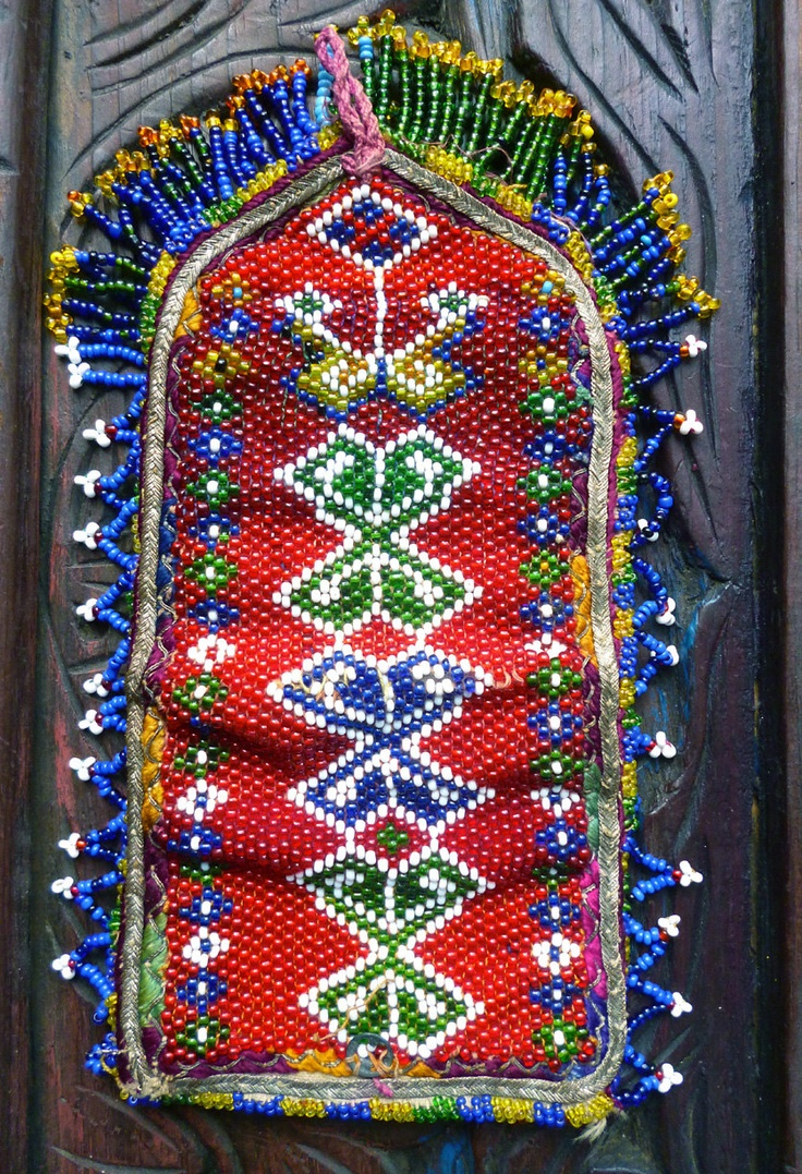 Old Afghan tribal pouch with red seed glass bead tribal motif - pocket to hold paper currency via Etsy.