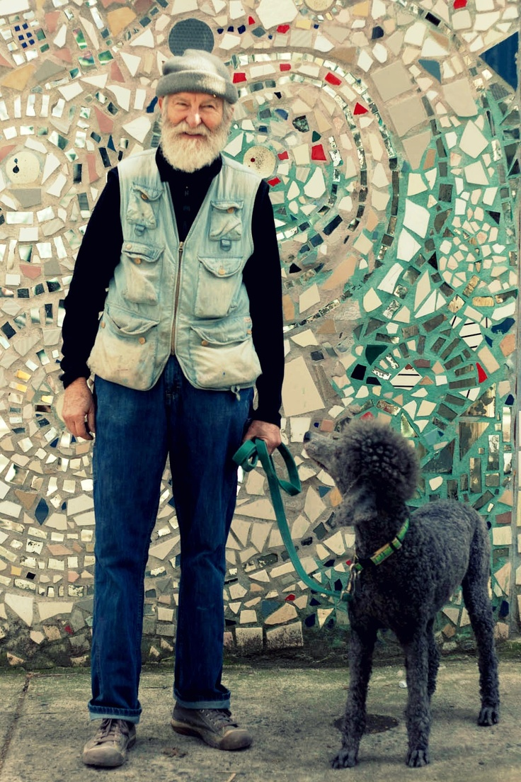 Isaiah Zagar - the artist who created this beautiful, hand-crafted wall art behind him