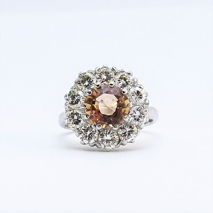 View this spectacular golden topaz and diamond cluster ring on our website #antiquerings #topaz #diamond #chriatmasideas
