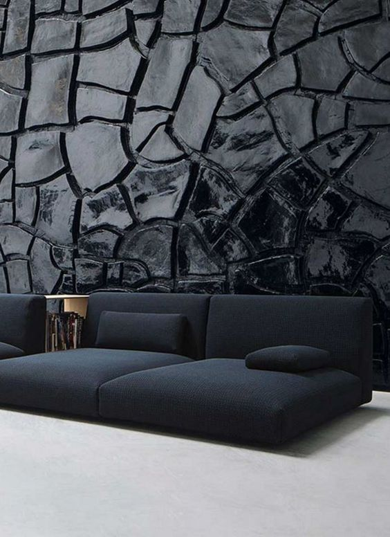Dark textured wall with dark blue sofa #textures #fabrics #moodboard wood, metal, textures inpirations. See more at http://www.brabbu.com/en/inspiration-and-ideas/category/materials: