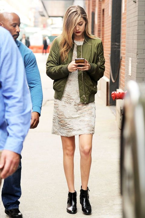 The model looked chic in an embellished dress with distressed touches, paired with an on-trend olive green bomber jacket and black booties.