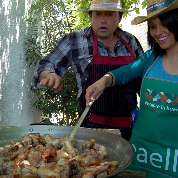 In Valencia the term paellera is used to describe the woman who cooks paella. The term paellera is never used to name the container in which the dish is cooked (even if it is the correct name for this container). The container is always known as paella.