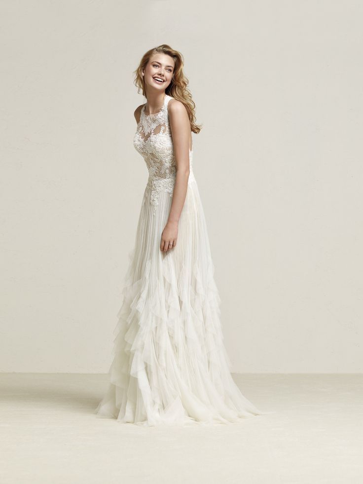 The textured skirt and racerback style is making this new arrival a hit with our #BHBrides!
