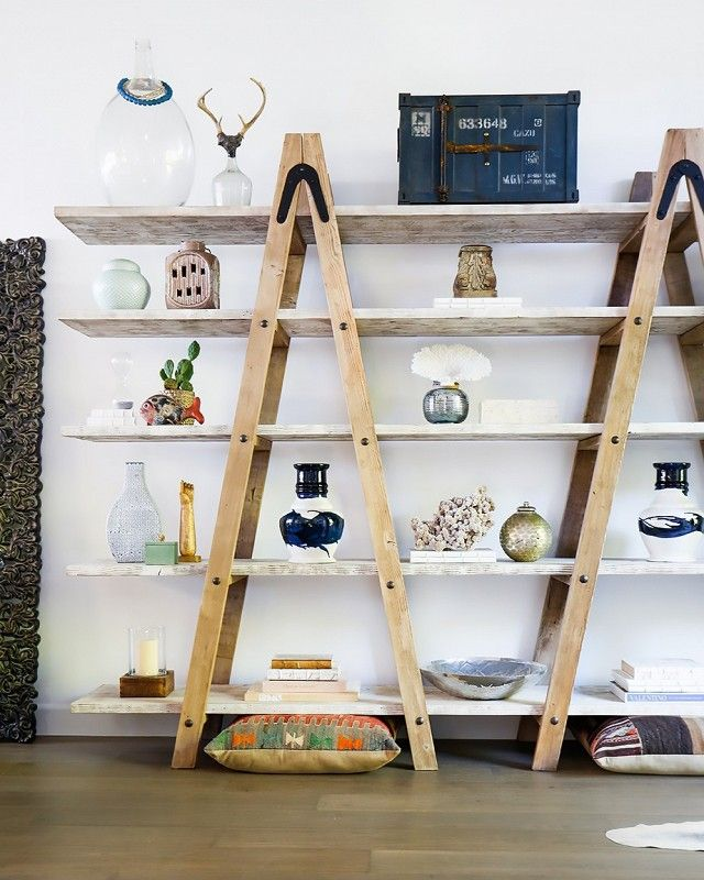 Eclectic shelving with heirlooms and pottery