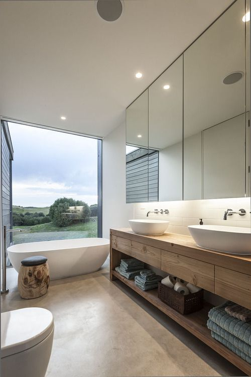 great use of materials; I love how the tub (next to the window) appears to match the bowls