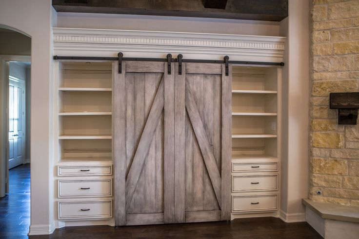 Beautiful built in entertainment center. With barn doors to hide your TV www.CopperBasinHome.com