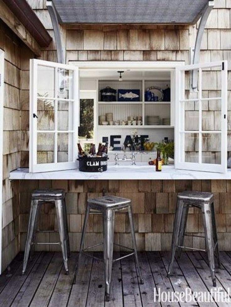 Marble shelf bar outside kitchen window, metal stools