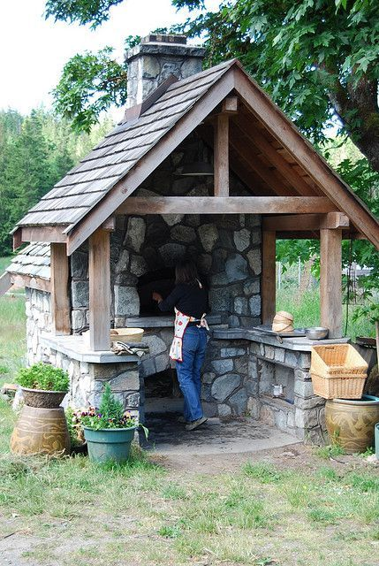 I like the duality between the stone and the wood, doesn't have to be exactly like it but presents a good shelter and oven idea.