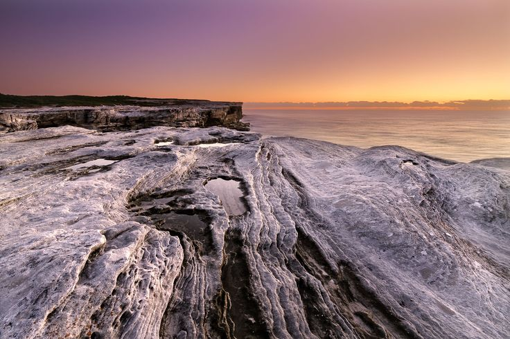 The wonderful rich colours of twilight Dawn on the cliff tops at Kamay Botany Bay National Park, NSW Australia