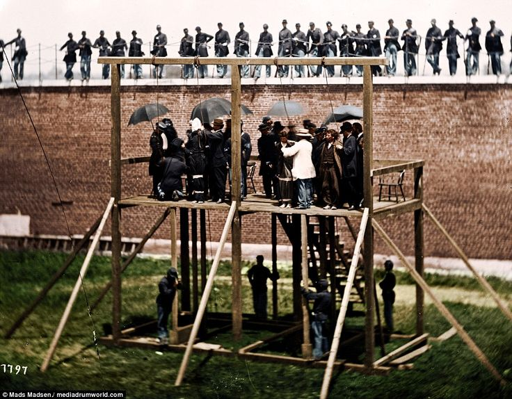 From left to right: Mary Surratt, Lewis Powell, George Atzerodt, David Herold being taken to the scaffold on July 7th 1865