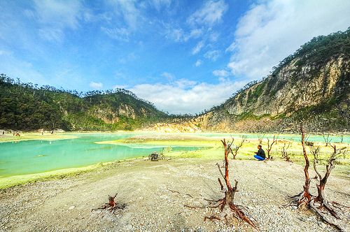 "Kawah Putih, Indonesia. Kawah Putih aka ""White Crater"", is a crater lake formation of Patuha Volcano. It is located about 50km south of Bandung. Sulphur powder surrounds the lake. The water is turquoise due to the sulphur content"