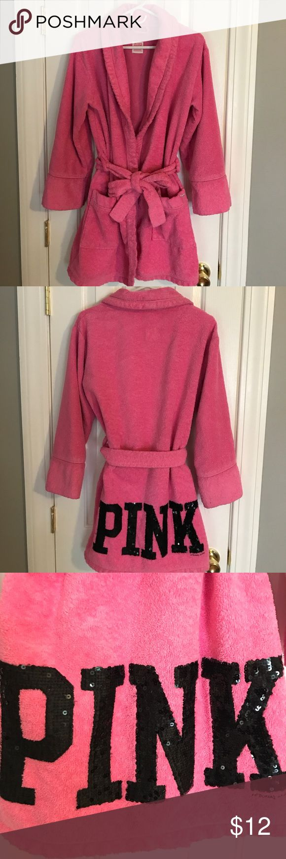 VS PINK robe Preloved Victoria's Secret PINK bathrobe in the color pink with black sequin lettering on back. Two pockets in the front, large sash to go around outside and inner dash to tie closed. ** preloved and preworn, some of the sequins have fallen off, zoom into picture to see. Still in good condition, very comfy, no stains or rips ** thicker material, like terry cloth so it keeps you nice and warm! PINK Victoria's Secret Intimates & Sleepwear Robes