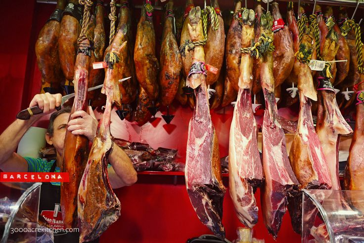 Jamón Ibérico stall in La Boqueria market — http://3000acrekitchen.com/paella-a-la-catalonia/