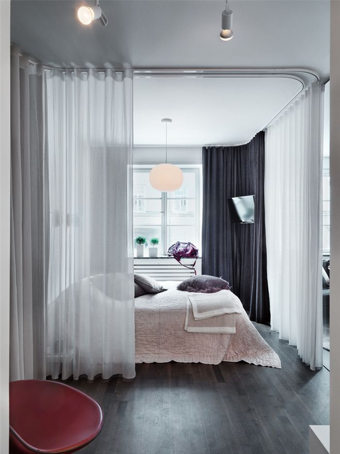 Bedroom with Flexible Curtain Tracks