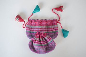 These cute little drawstring purses are a colourfulway to store small stuff. Available in several colours. Pull one set of cords to open and the other to close - a clever little design.