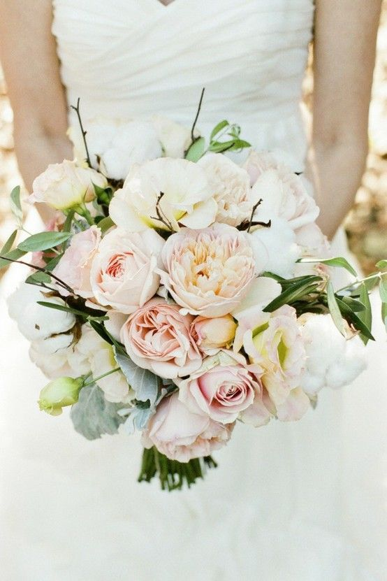 The bride will carry a loose clutch bouquet of cream hydrangeas, blush garden roses, pale blush garden roses, blush lisianthus, grey dusty miller, and olive branches wrapped in ivory ribbon.